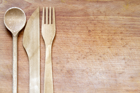 Wooden cutlery on cutting board abstract food background Reklamní fotografie