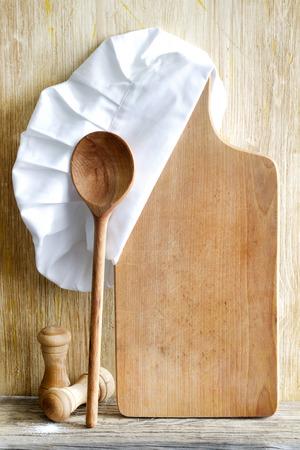 Sombrero del cocinero y la tabla de cortar alimentos vacío abstracto Foto de archivo