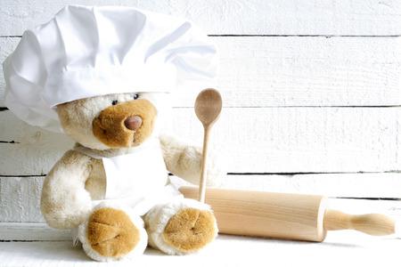 teddybear: Teddy bear in chef hat with spoon abstract food  Stock Photo