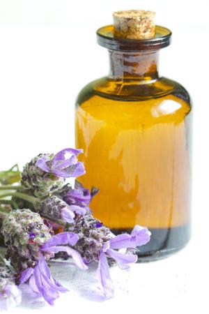 Lavender oil on white planks closeup