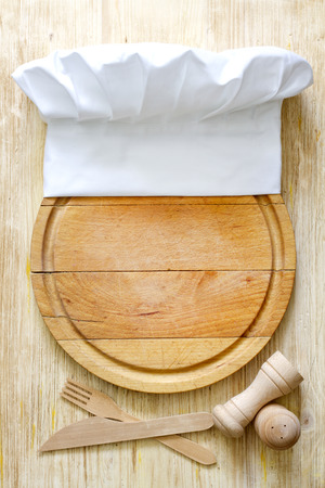 cook book: Chef hat on cutting board abstract food concept