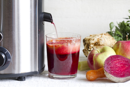 extractor: Juicer and juice with fresh fruits and vegetables