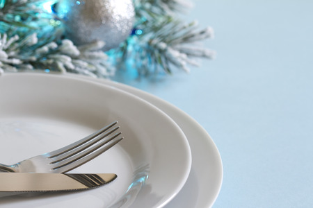 wine and dine: Christmas table with cutlery and tableware abstract background