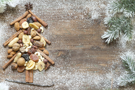 Christmas tree with dried fruits and nuts abstract background photo