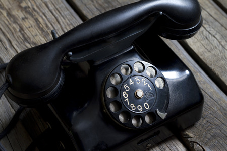 hot line: Old retro telephone on vintage boards