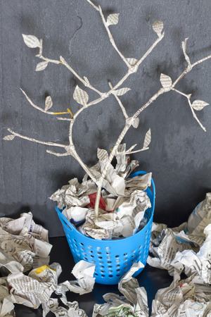 unique concept: Paper tree in recycle trash can unique abstract concept Stock Photo