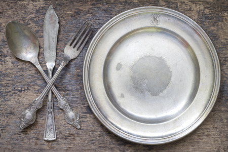vintage cutlery: Old vintage cutlery and dishware abstract food background
