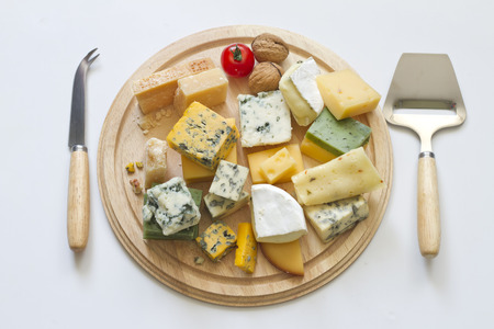 veggie tray: Various types of cheese on white abstract still life Stock Photo