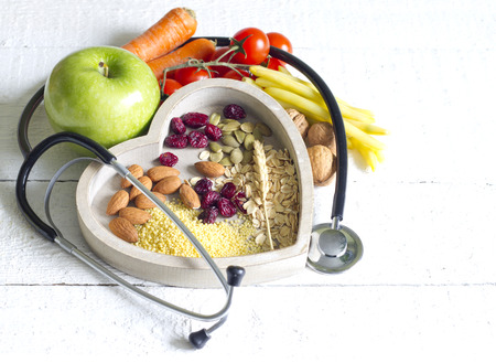 food on white: Healthy food in heart diet abstract concept Stock Photo