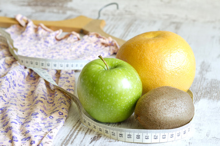 lose weight: Lose weight to clothes concept with dress and fruits diet
