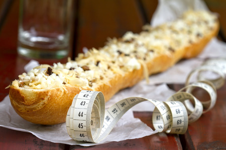 casserole: Baguette with cheese and measure diet concept Stock Photo