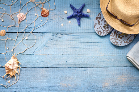 Seashells on blue boards vacation holiday background abstract concept