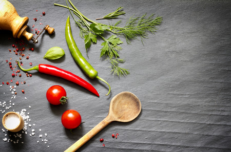black stone: Spices and herbs creative food background concept Stock Photo
