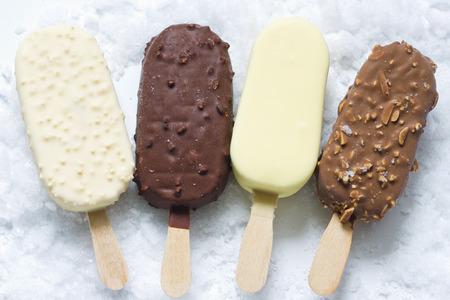 Ice cream on stick in ice Foto de archivo