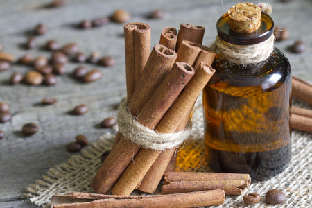 Cinnamon sticks and bottle with oil