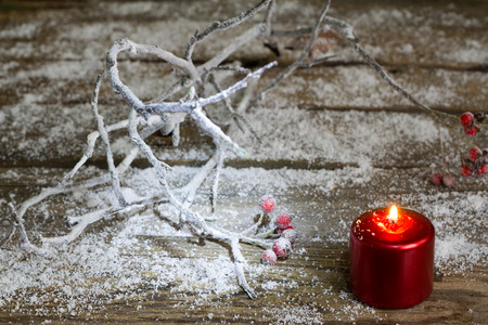 christmas candle: Christmas red candle and branches in snow on old boards Stock Photo