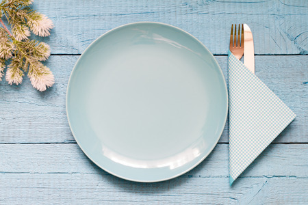 table set: Christmas table and empty plate background concept blue