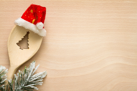 tree cutting: Christmas tree in spoon abstract food background concept