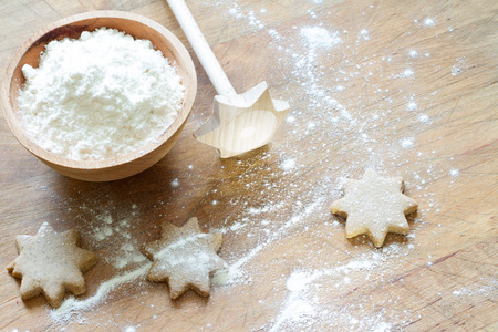 christmas baking: Christmas baking abstract star cookies with flour Stock Photo