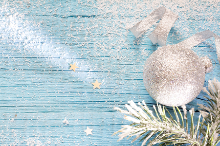 shiny christmas baubles: Snow and fir abstract christmas blue wooden background
