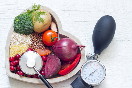 Healthy food in heart and lowering pressure sign concept