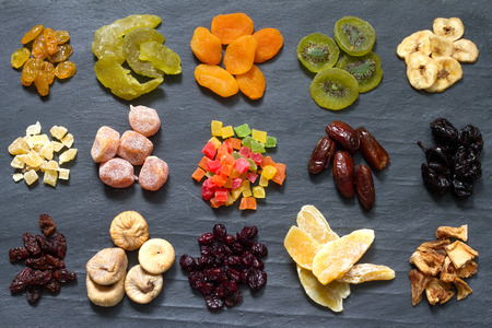 crystallized: Candied dried mixed assortment of exotic fruits on black marble