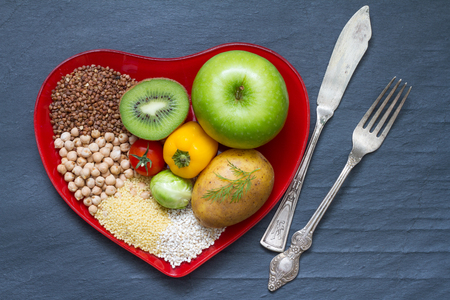 food still: Health food on a red heart plate diets abstract still life