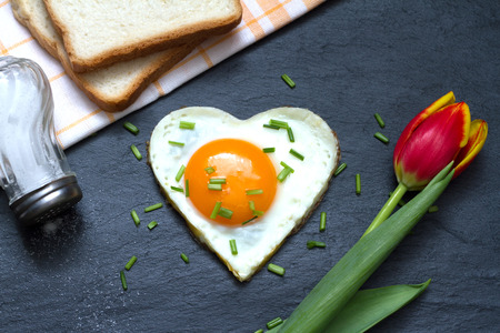valentines gift: Valentines Day abstract breakfast with egg heart and tulip