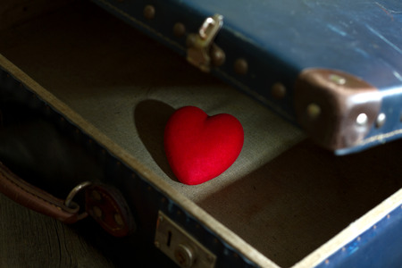 abstract love: Heart in suitcase abstract of loneliness in love Stock Photo