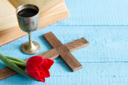 chalice: Easter cross bible and chalice tulip on blue background