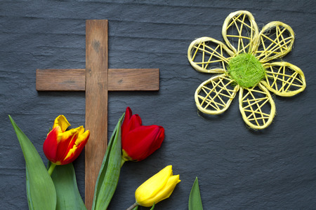 easter cross: Abstract easter tulips and wooden cross on black marble