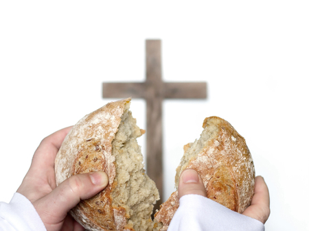 Sharing of bread as a last supper easter concept Stock Photo