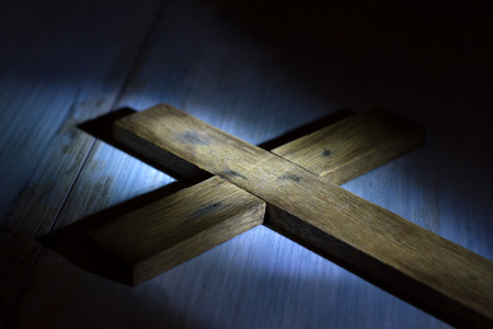 Old retro wooden cross in night abstract easter concept