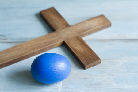 grunge cross: Old vintage cross and abstract blue easter egg symbol simple idea Stock Photo
