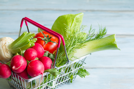 basket: Spring vegetables in shopping basket Stock Photo