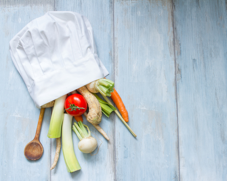 abstract food: Vegetables in chefs hat cooking food abstract concept