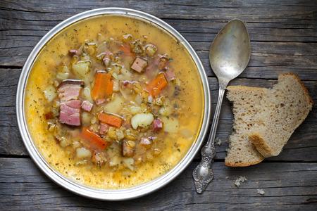 pea: Split pea soup on vintage wooden table