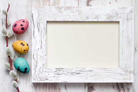 Easter eggs and empty vintage photo frame background