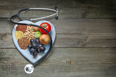 Healthy lifestyle concept with food on heart