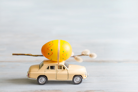 Easter eggs and catkins on car abstract retro concept Standard-Bild