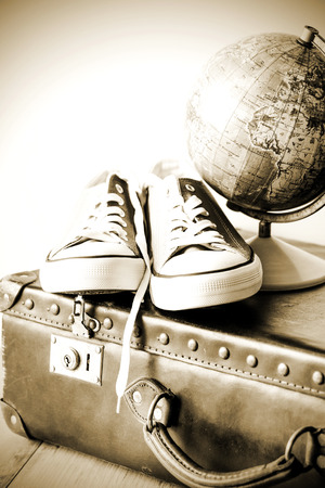 globetrotter: Old retro holiday suitcase and shoes for globetrotter