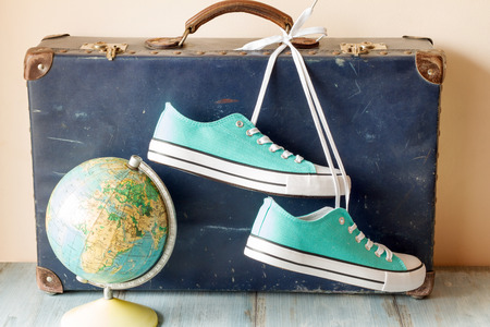 vintage travel: Travel concept with holiday suitcase, shoes and globe Stock Photo