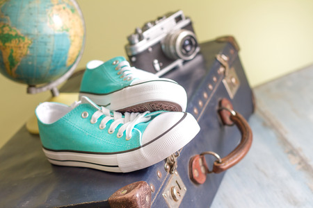 vintage travel: Travel around the world concept with holiday suitcase Stock Photo