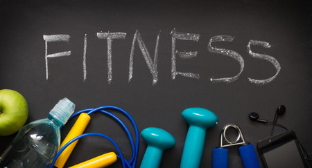 sports gear: Fitness and sports gear on blackboard abstract background