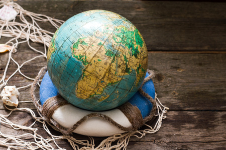 environmental awareness: Globe on the lifebuoy earth day and save the world concept