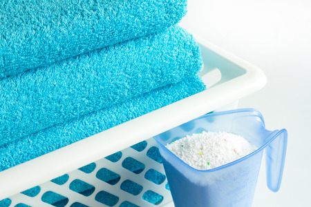 Laundry blue towels and washing powder Archivio Fotografico