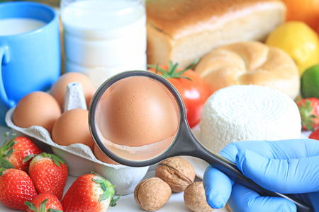 food allergy: Allergy food abstract concept with examining doctor and magnifier