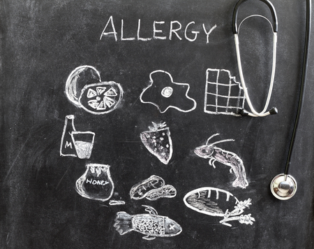 un healthy: Allergy food and beverages on blackboard concept