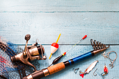 tackle: Fishing tackle on wooden blue background Stock Photo