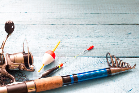 rhodium: Fishing tackle on wooden blue background Stock Photo